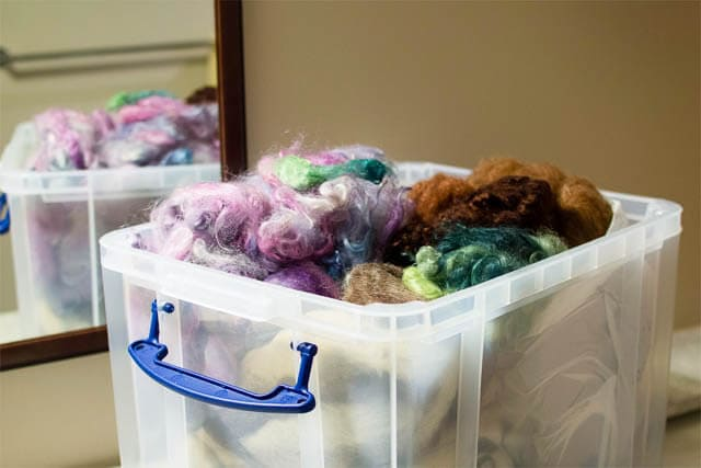 Storing your fibre in plastic containers (Photo by Grace Verhagen)