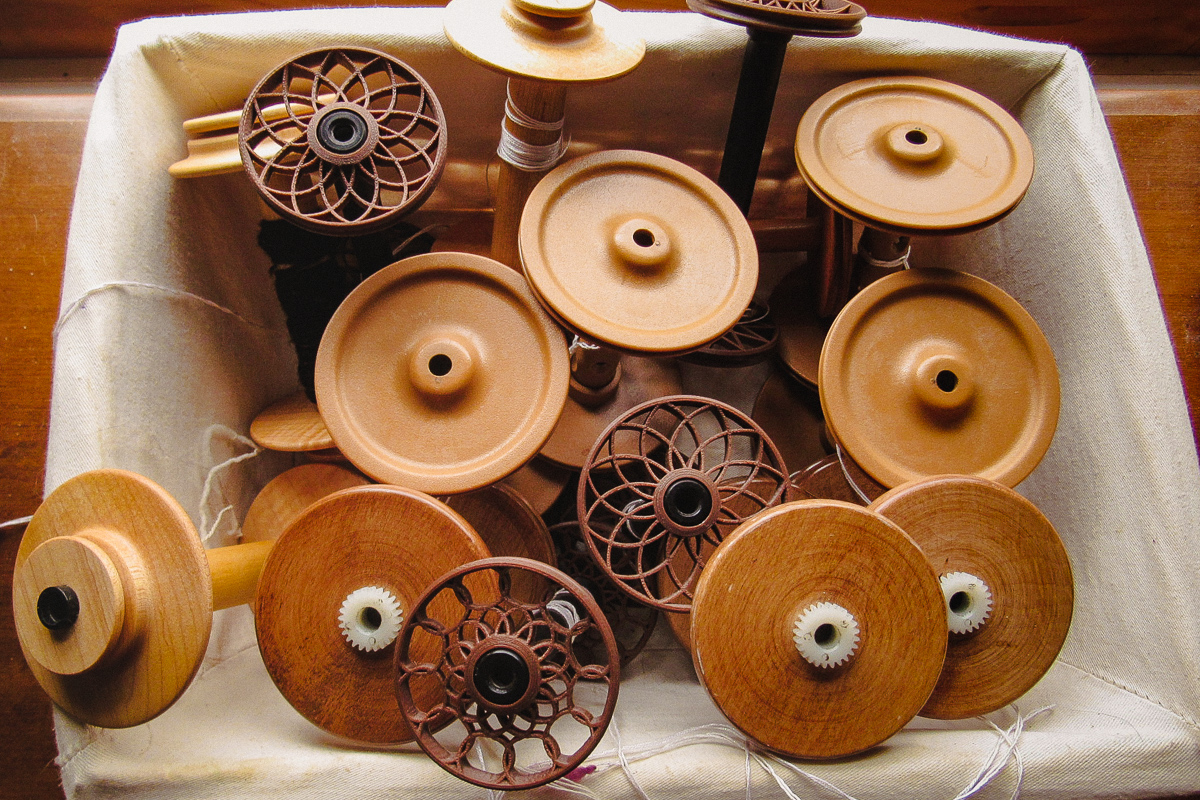 Lots of extra bobbins for spinning, photo by Debbie Held