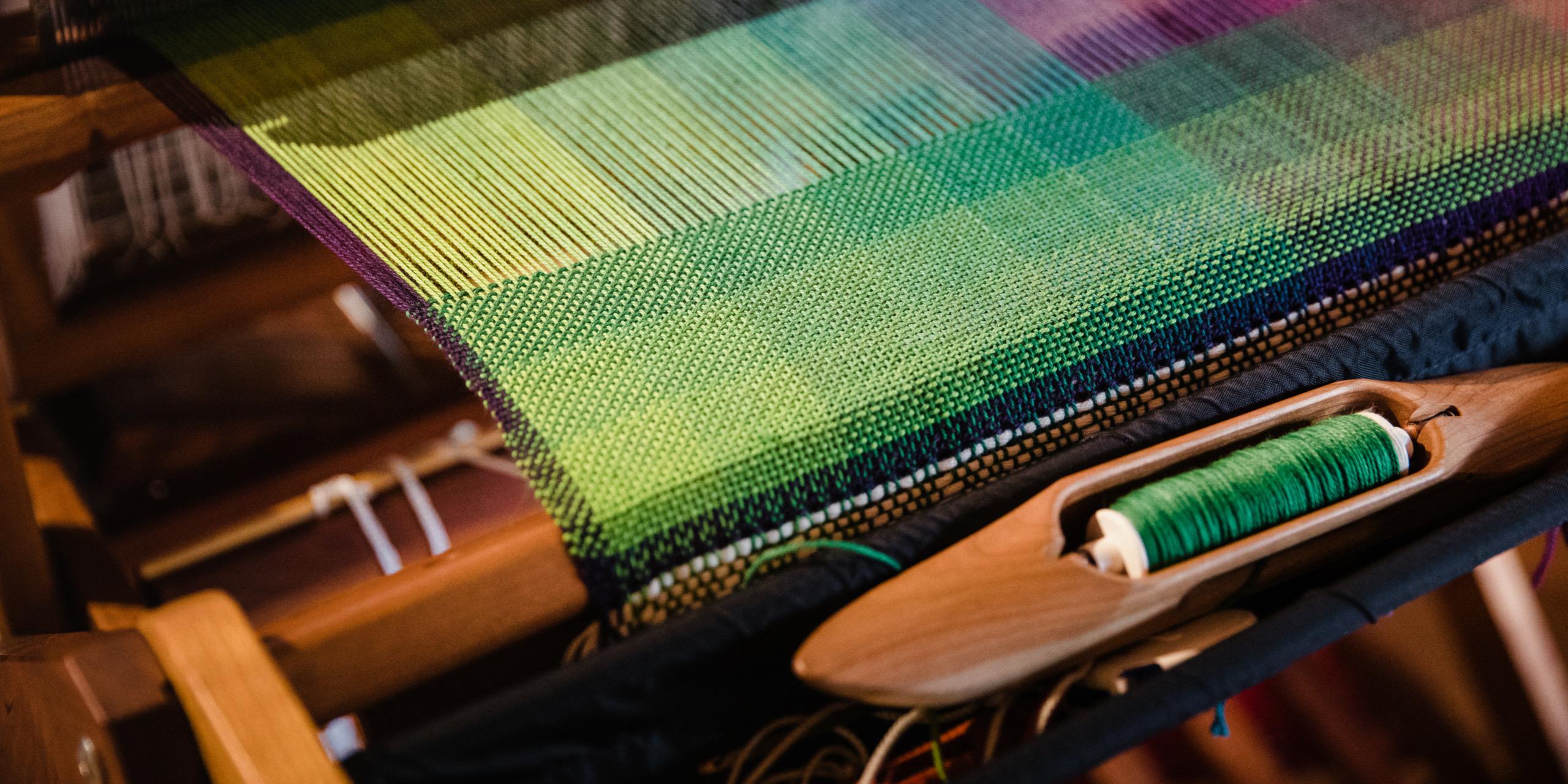 Handwoven colour gamp shawl using SweetGeorgia yarns
