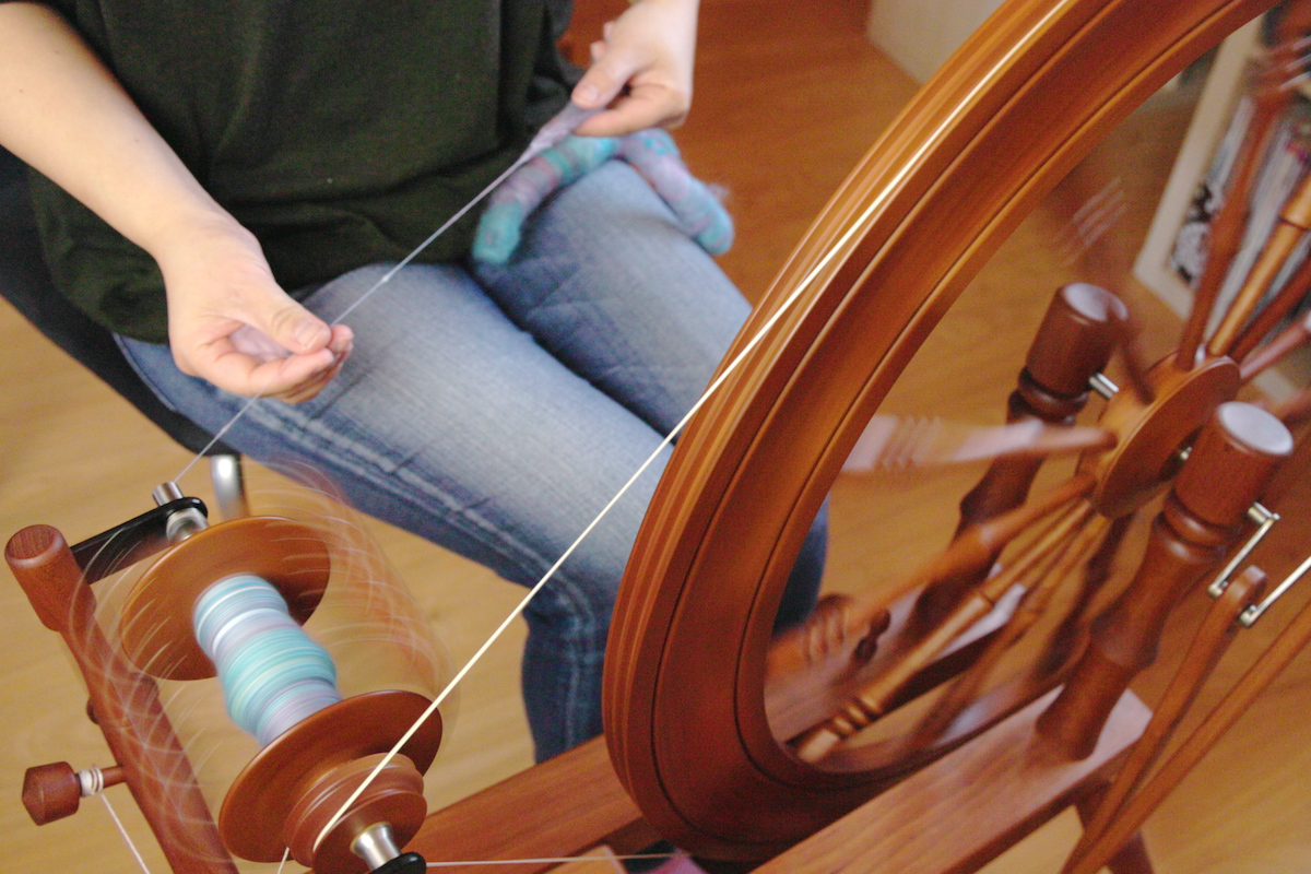 Felicia Lo Wong spinning rolags on a Lendrum Saxony wheel