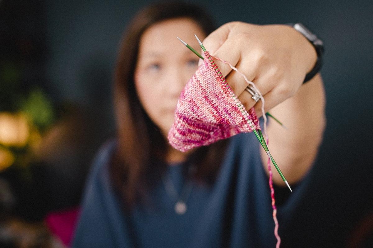 Felicia Lo Wong knitting toe up socks on the Taking Back Friday vlog